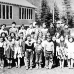 Ymir School 1953 Row 1: Wayne Anderson, Jimmy Lang, Preston Zebin, Harry McDonald, Wayn Kinee, Gary Gowing, Dale Tetz, Billy Williams. Row 2: Ronald Ekstrom, David Smith, Anne Kosenic, Virginia Lundgren, Nick Bowolin, Leo Ritter, Heather Medine, John Edwardson, Diane Borg