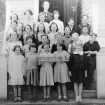 Ymir School April 1938. Div. II Teacher Miss N. Irving - original photo courtesy P. Anderson Row 1: Alice Lang, unknown, Lena Fresu, Mary Nord, Gloria McKay. Row 2: Mary Lang, unknown, unknown, Lawrence Bond, Bruce McKay, unknown, Row 3: Dorthy Chrysler, Funice Chrysler, unknown, unknown, Roy Fresu, unknown. Back Row: unknow, Sigrid Nord, Betty B